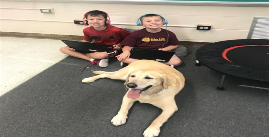kids sitting with dog